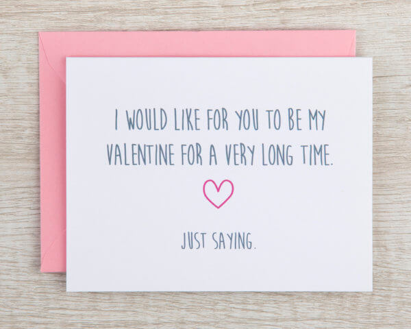 """Fun valentine's day card that reads """"I would live for you to be my Valentine for a very long time. Just saying."""" in grey with a pink heart"""