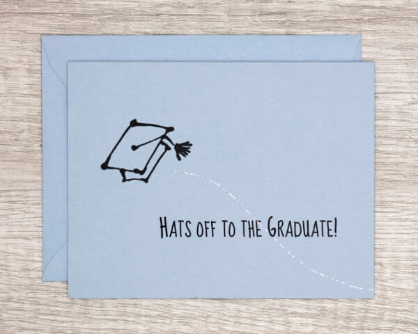 """Blue congratulations graduation card the features a mortarboard being tossed in the aair with a sparkly trail that reads """"hats of to the graduate!"""""""