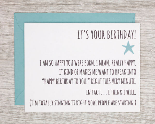 """Quirky fun birthday card that reads """"it's your birthday! I am so happy you were born. I mean, really happy. It kind of makes me want to break into 'Happy Birthday to you!' right this very minute. In fact...I think I will. (I'm totally singing it right now. People are staring."""" with a small blue star and blue envelope"""