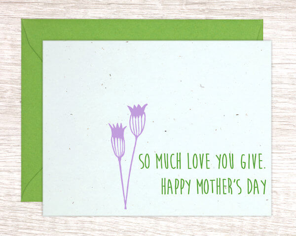 """Blue handmade greeting card with a purple thistle that reads """"So much love you give. Happy Mother's Day"""" in green with a green envelope"""