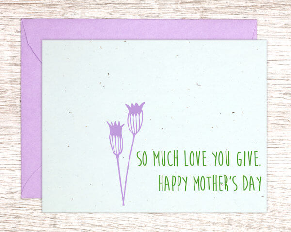 """Blue handmade greeting card with a purple thistle that reads """"So much love you give. Happy Mother's Day"""" in green with a purple envelope"""