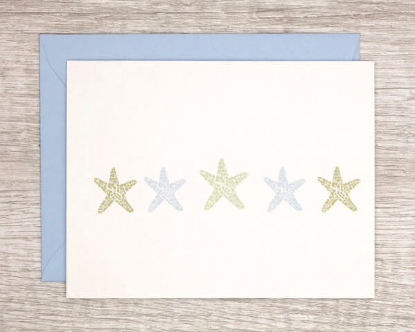 Beach-themed anytime greeting card that features 5 starfish in blue and green with a matching blue envelope