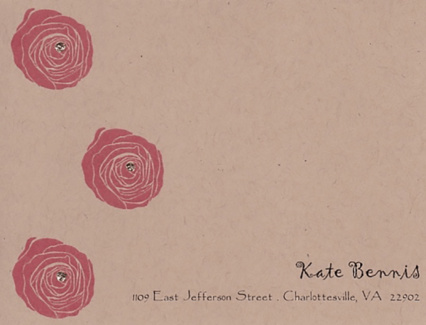 A rustic custom greeting card with a name, address, and sparkly red flowers