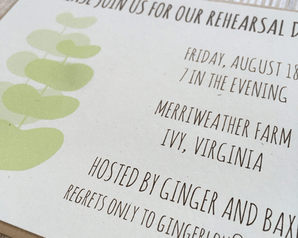 A custom wedding rehearsal invitation with a green plant pattern and a brown rustic envelope