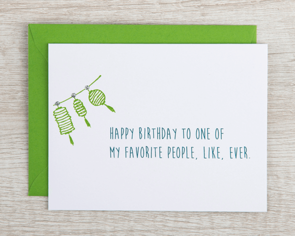 """a handmade birthday card that reads """"Happy birthday to one of my favorite people, like, ever"""" with a string of green paper lanterns"""