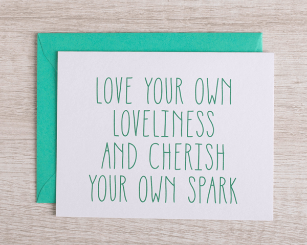 """A friendly greeting card that reads """"Love your own loveliness and cherish your own spark"""" in green with a matching envelope"""