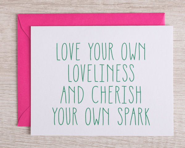 """A friendly greeting card that reads """"Love your own loveliness and cherish your own spark"""" in green with a complementary hot pink envelope"""
