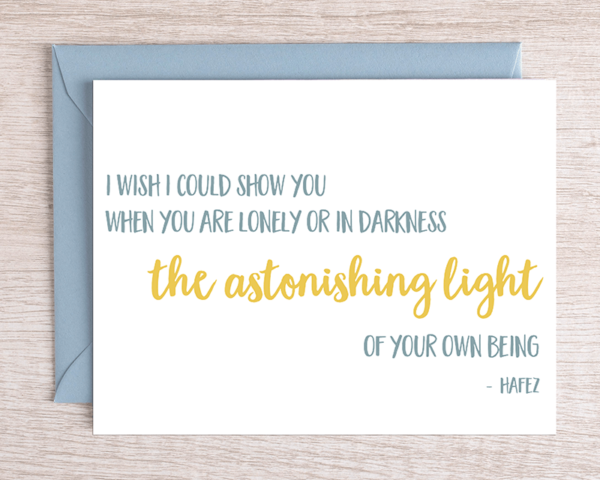 """A motivational greeting card that reads """"I wish I could show you when you are lonely or in darkness the astonishing light of your own being. - Hafex"""" in sunny yellow and grey-blue with a blue envelope"""