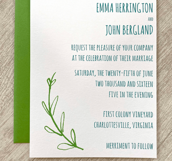 A custom wedding invitation with teal text and a pretty green branch