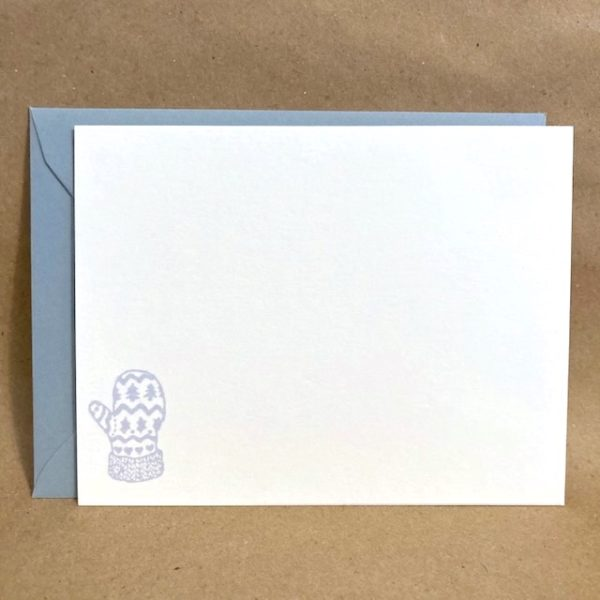 A holiday card featuring a small blue winter mitten and a matching blue envelope