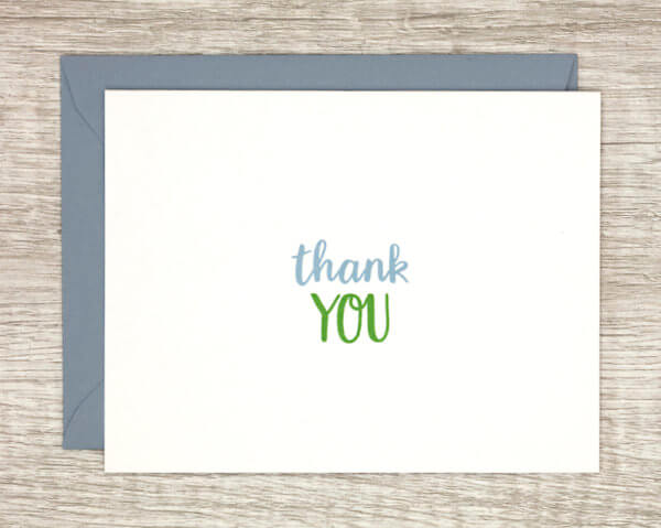 """Gratitude card that reads """"thank you"""" in blue and green with a matching blue envelope"""
