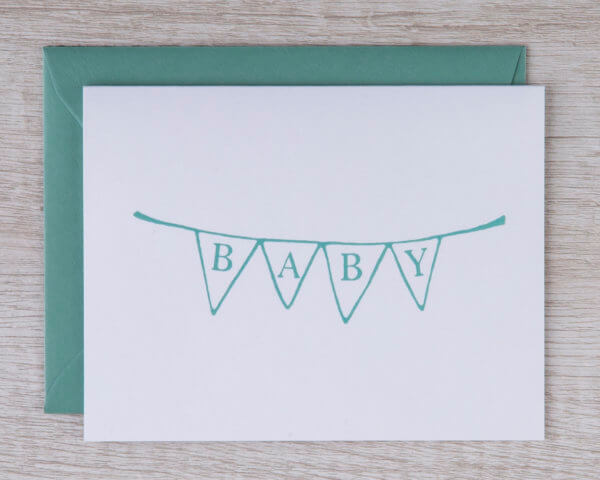 "Baby congratulations greeting card with a green bunting banner that reads ""baby"" for any gender"