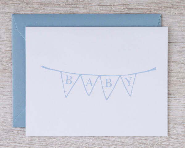 "Boy baby congratulations greeting card with a blue bunting banner that reads ""baby"""