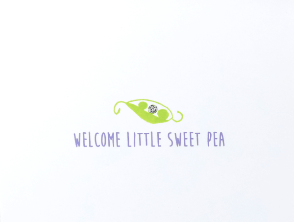 """White baby congratulations card with a stylized green peapod that reads """"welcome little sweet pea"""" in purple"""