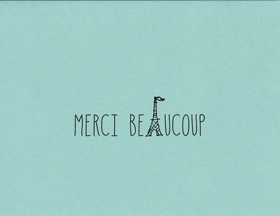 """Paris-themed blue thank you card that reads """"merci beaucoup"""" and features a small sketch of the eiffel tower"""