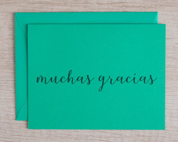 """Teal handmade greeting card that reads """"muchas gracias,"""" thank you in Spanish"""