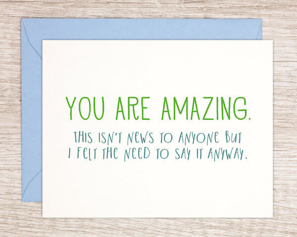 "Everyday encouragement greeting card that reads ""you are amazing"" in green and ""this isn't news to anyone but I felt the need to say it anyway"" in blue with a blue envelope, made in Massachusetts"