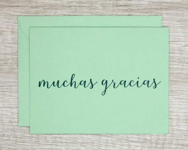 "Teal handmade thank you card that reads ""muchas gracias"" in Spanish"