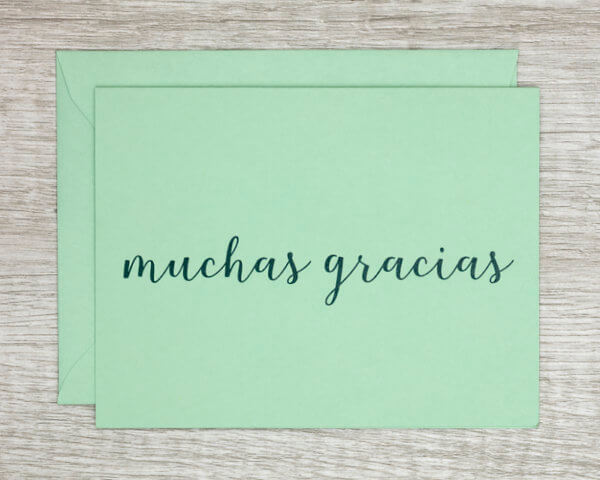 """Teal handmade thank you card that reads """"muchas gracias"""" in Spanish"""