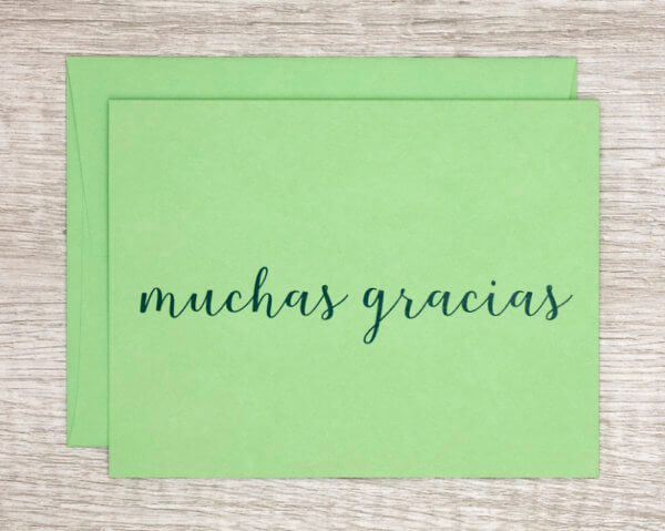 """Green handmade thank you card that reads """"muchas gracias"""" in Spanish"""
