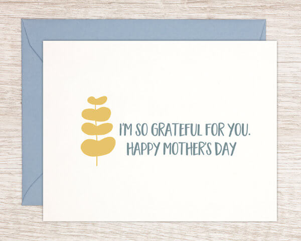 """White card featuring a fun yellow leaf pattern that reads """"I'm so grateful for you. Happy Mother's Day"""" with a blue envelope"""